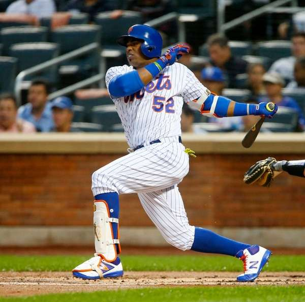Yoenis Cespedes of the Mets follows through against the