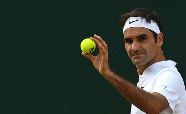 Roger Federer in action against Tomas Berdych during