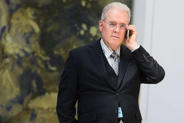 Billionaire Robert Mercer speaks on the phone during