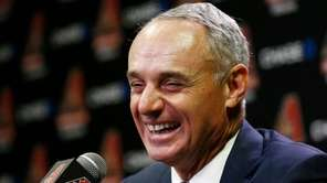Rob Manfred, Commissioner of Major League Baseball, laughs during