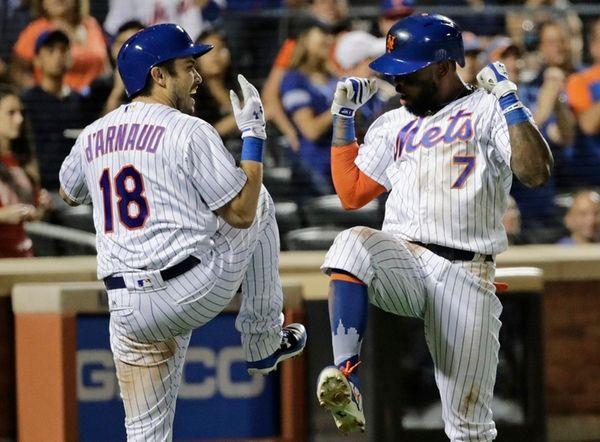 The Mets' Travis d'Arnaud celebrates with Jose Reyes