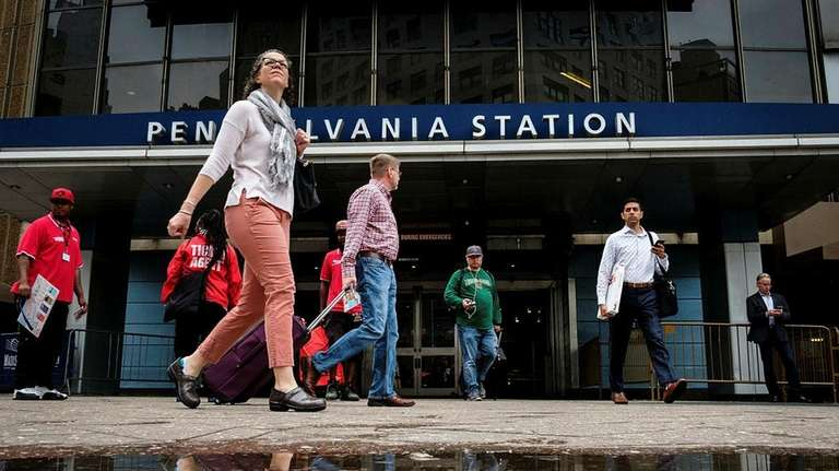 Travelers exit Penn Station in Manhattan on May
