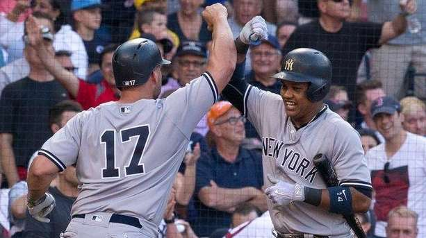 Matt Holliday of the Yankees celebrates with Starlin