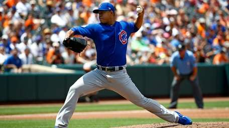 Chicago Cubs starting pitcher Jose Quintana throws to