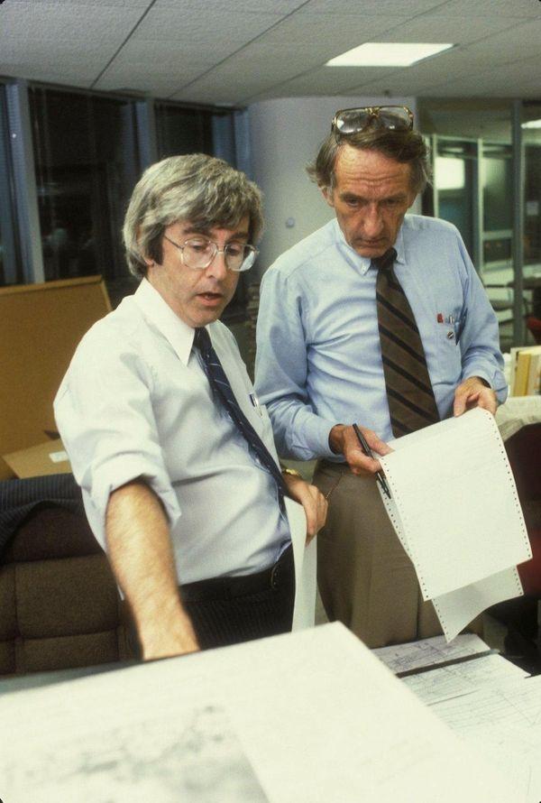 John Hanchette, left, and John Quinn work at