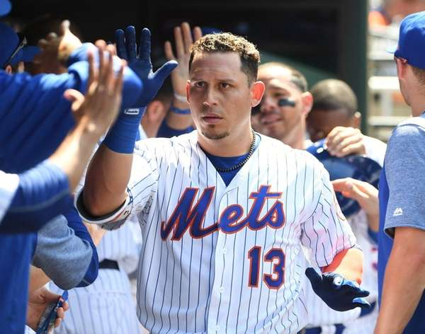 Mets second baseman Asdrubal Cabrera is greeted