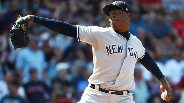 Aroldis Chapman of the Yankees delivers in the