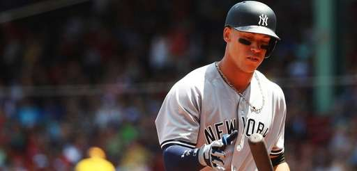 Yankees' Aaron Judgereacts after striking out in the