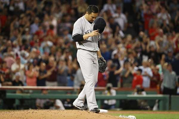 Masahiro Tanaka of the Yankees reacts after giving