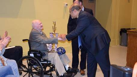 William George Houston receives a trophy at the