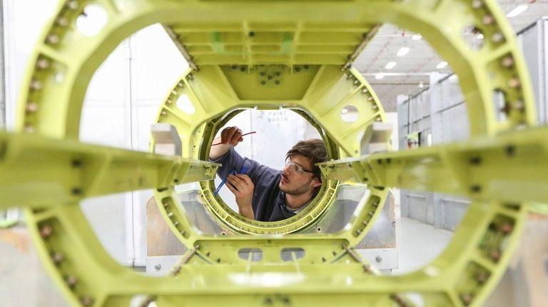 Sealer Chris Zec works on a Grumman external