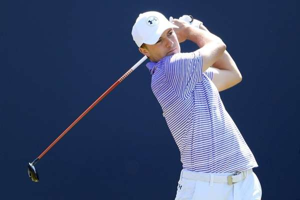 Jordan Spieth hits his tee shot on the first