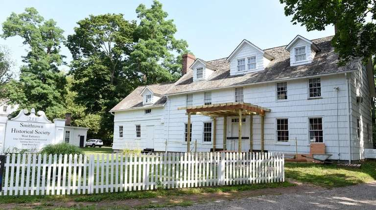 A new, historically accurate porch is under construction
