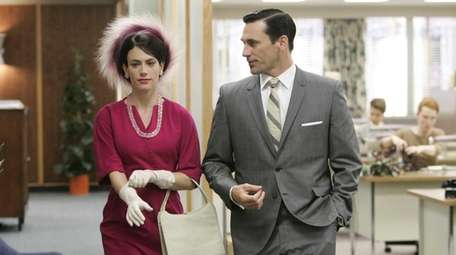 Don Draper (Jon Hamm) and one of his