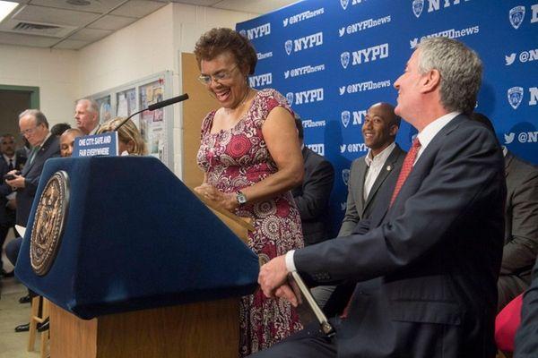 Community activist Beth De Beetham, left, joins Mayor