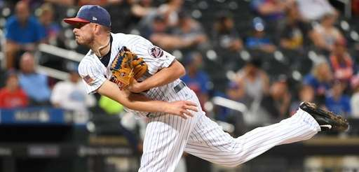 New York Mets relief pitcher Addison Reed follows