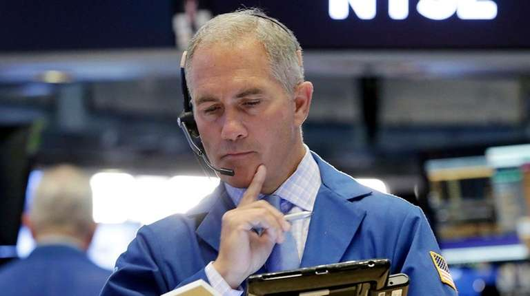 Trader Timothy Nick works on the floor of