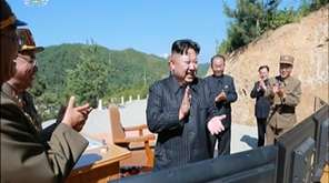 North Korean leader Kim Jung Un, center, applauds