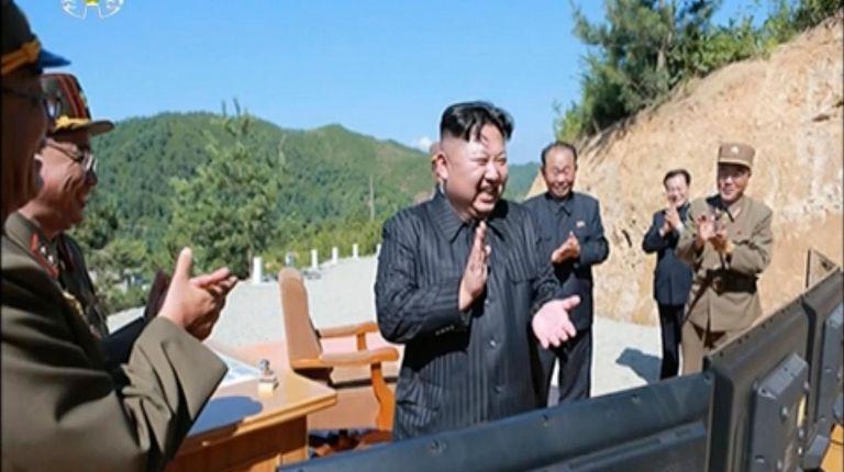 North Korean leader Kim Jung Un, center, applauds