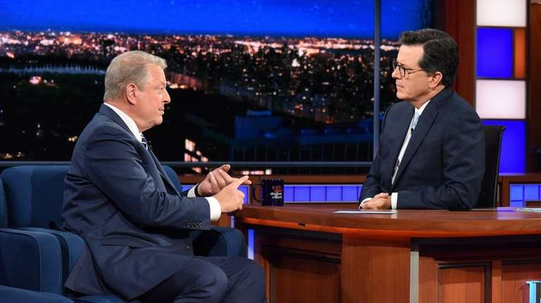 Guest Al Gore and host Stephen Colbert during