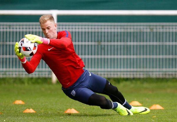 England's goalkeeper Joe Hart makes a save during