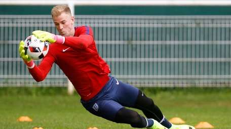 England's goalkeeper Joe Hart makes a save during
