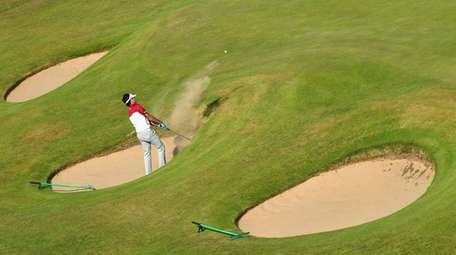 Bubba Watson of the United States hits a