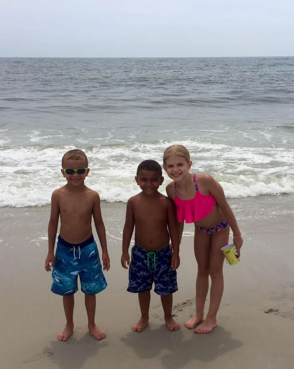 Kyle, Caden & Lily looking for shells at