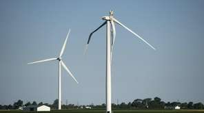 A broken wind turbine, right, in Nextera Energy's