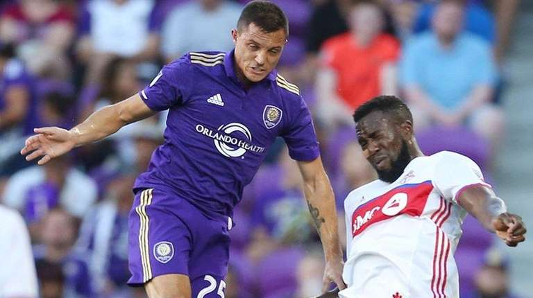 Orlando City's Donny Toia and Toronto FC's Jozy