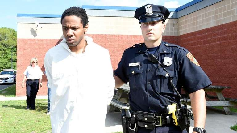 Michael Hunter, 29, is led out of the