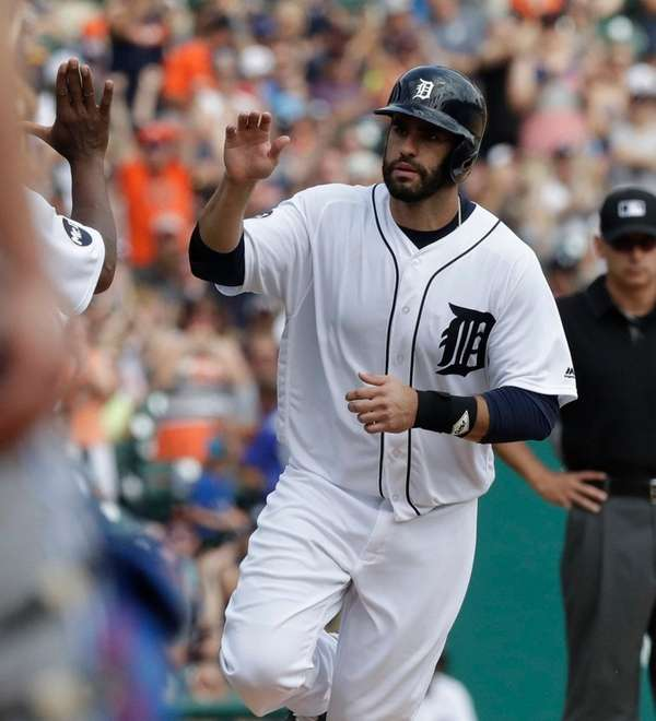 The Tigers' J.D. Martinez rounds the bases after