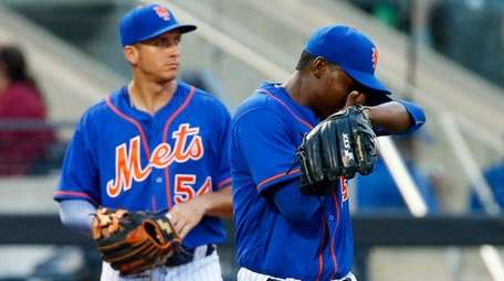 Rafael Montero of theMets reacts against theCardinals asT.J.