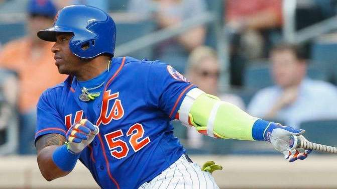 Yoenis Cespedes of the Mets follows through on