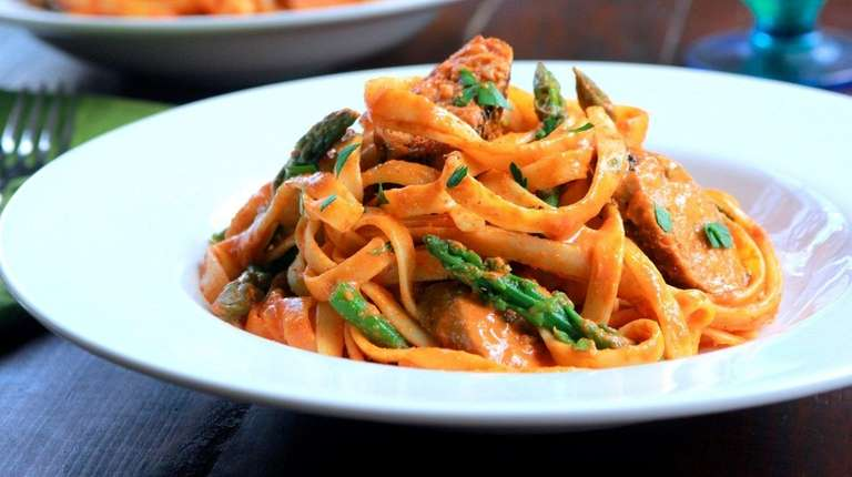 Pasta, turkey sausage and asparagus are dressed with