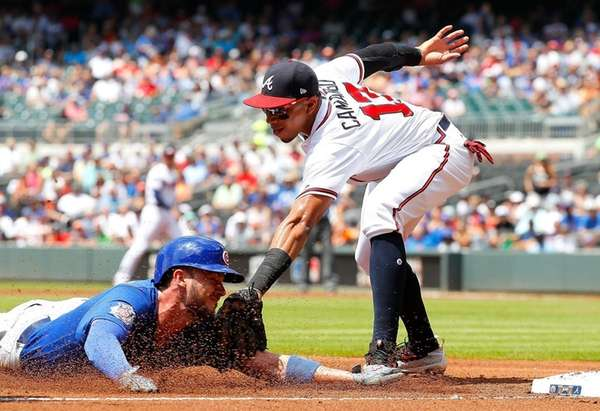 Cubs' Kris Bryant is tagged out while trying to