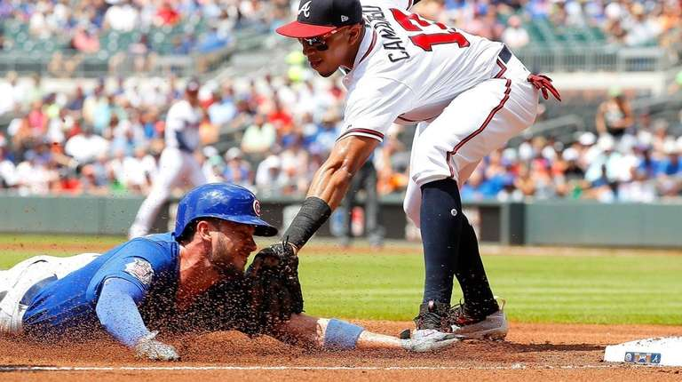 Cubs' Kris Bryantis tagged out while trying to