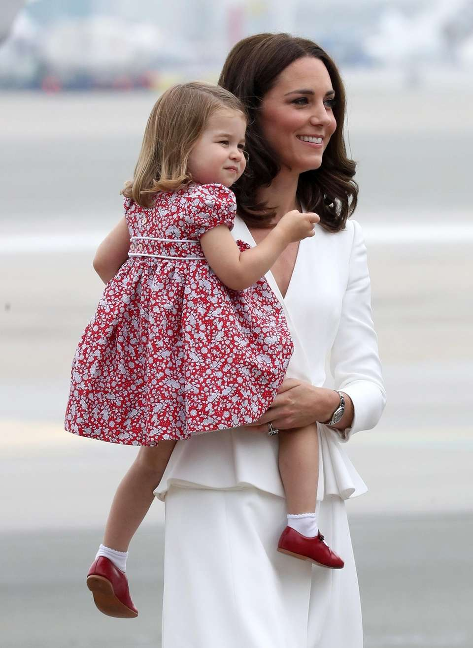 Catherine, Duchess of Cambridge carries Princess Charlotte of