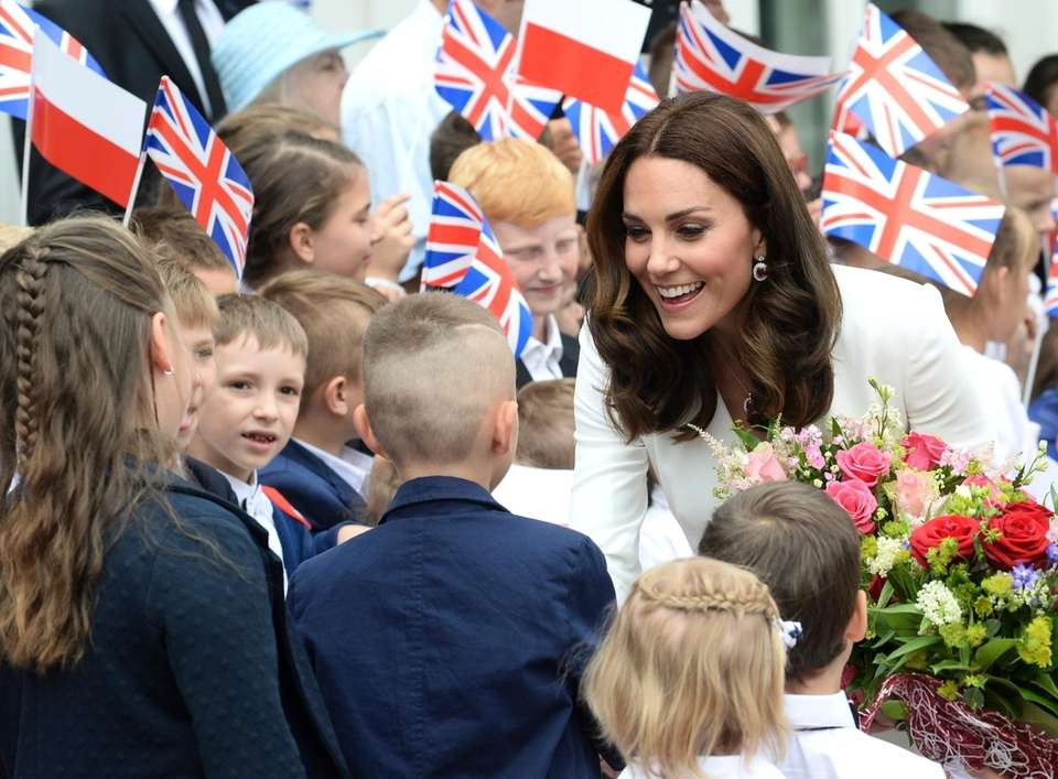 Children welcome Britain's Kate, the Duchess of Cambridge,