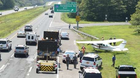 A small plane sits on eastbound Sunrise Highway
