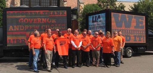 Representatives of Long Island labor unions celebrate the