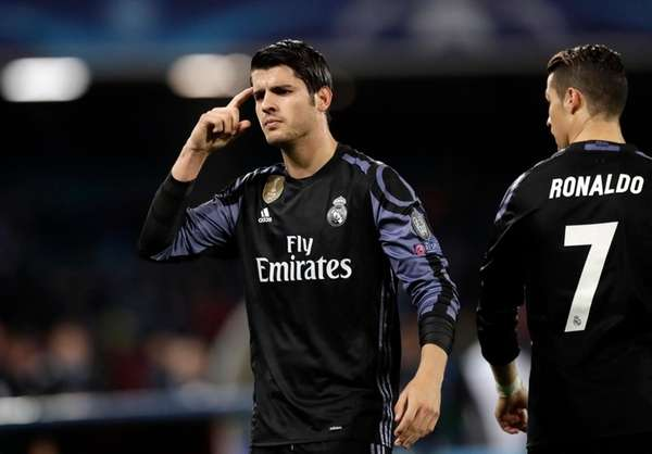 Real Madrid's Alvaro Morata gestures after scoring his