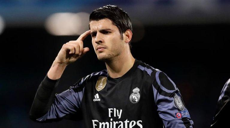 Real Madrid's Alvaro Morata gestures after scoring his