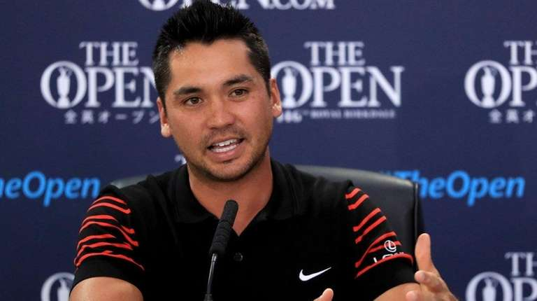 Jason Day speaks to the media during a