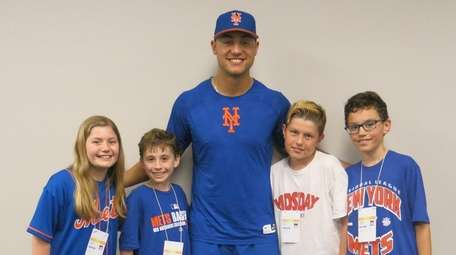 Mets outfielder Michael Conforto with Kidsday reporters, from