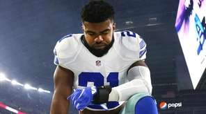 Ezekiel Elliott of the Cowboys takes a knee at AT&T