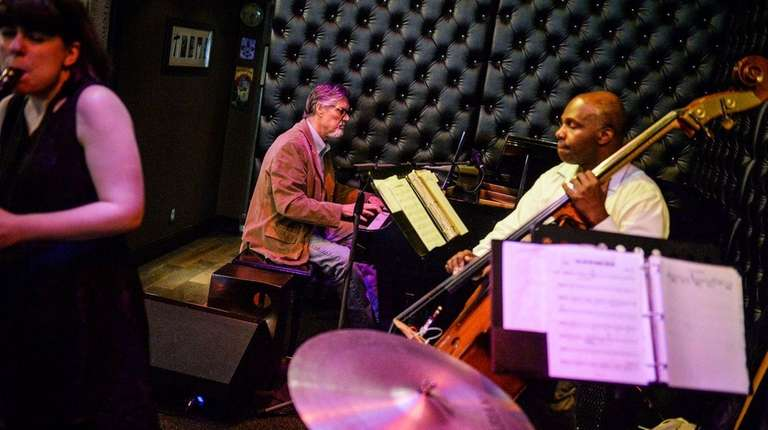 Lepley, center, plays with bassist James Cammack at