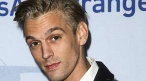 Singer Aaron Carter arrives at a premiere of