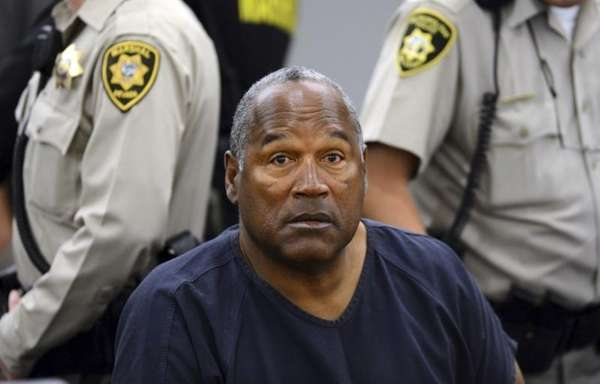 O.J. Simpson sits during a break on the