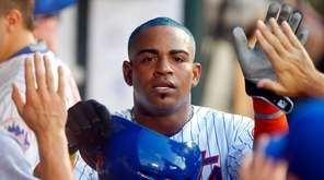 Yoenis Cespedes of the Mets celebrates in the dugout against